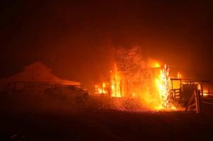The Kincade Fire burns a structure on 27 October 2019 in Santa Rosa, California.