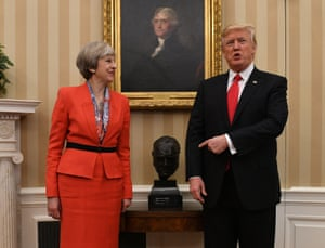 Theresa May meets Donald Trump by a bust of Winston Churchill in the Oval Office, in January.