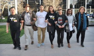 Gibson, second from left, with relatives of passengers on MH370 including Grace Subathirai Nathan, second from right, after a meeting in Canberra, Australia.