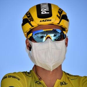 Team Jumbo-Visma rider Primoz Roglic of Slovenia, wearing the overall leader's yellow jersey.