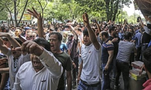 A group of protesters, including traders from the Grand Bazaar in Tehran, take to the streets.