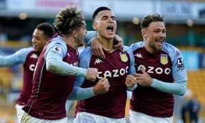 Anwar El Ghazi celebrates with Jack Grealish and Matty Cash after scoring a late winner for Villa.