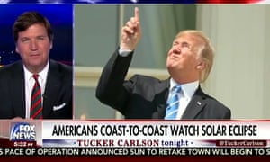 Fox News anchor Tucker Carlson was impressed with the way Donald Trump watched the solar eclipse without glasses. Carlson described it as 'perhaps the most impressive thing any president has done'.