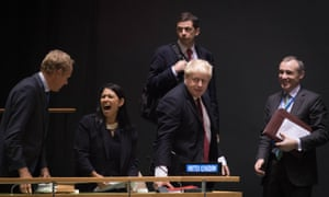 Cabinet ministers Priti Patel and Boris Johnson wait to hear Theresa May address the United Nations in September