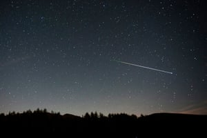A swarm of meteorites burns up in the atmosphere above San Miguel de Aguayo village in Cantabria, Spain