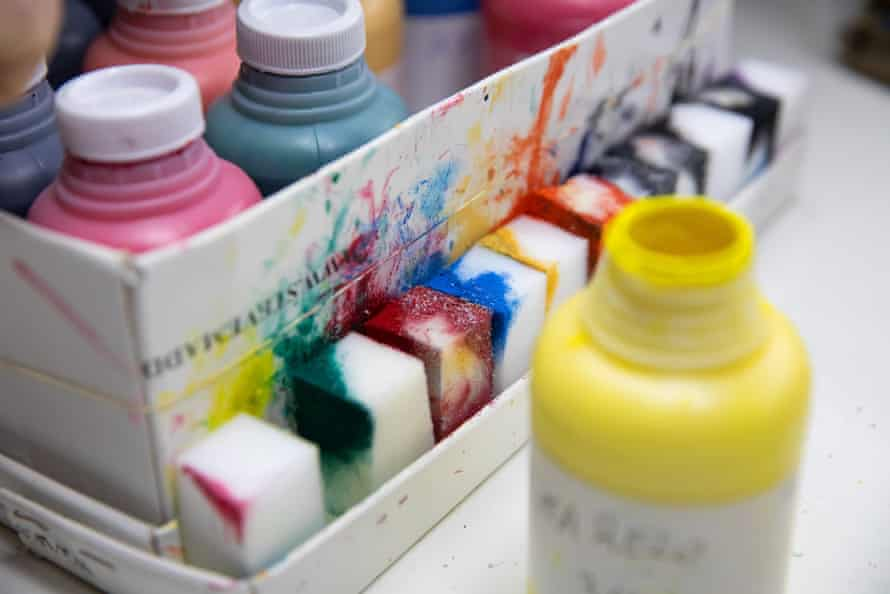 Coloured dyes in the factory which are used to mark the sizes of the stencils.
