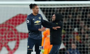 Chris Smalling was approached on the pitch by a supporter shortly after Arsenal had scored to make it 2-0.