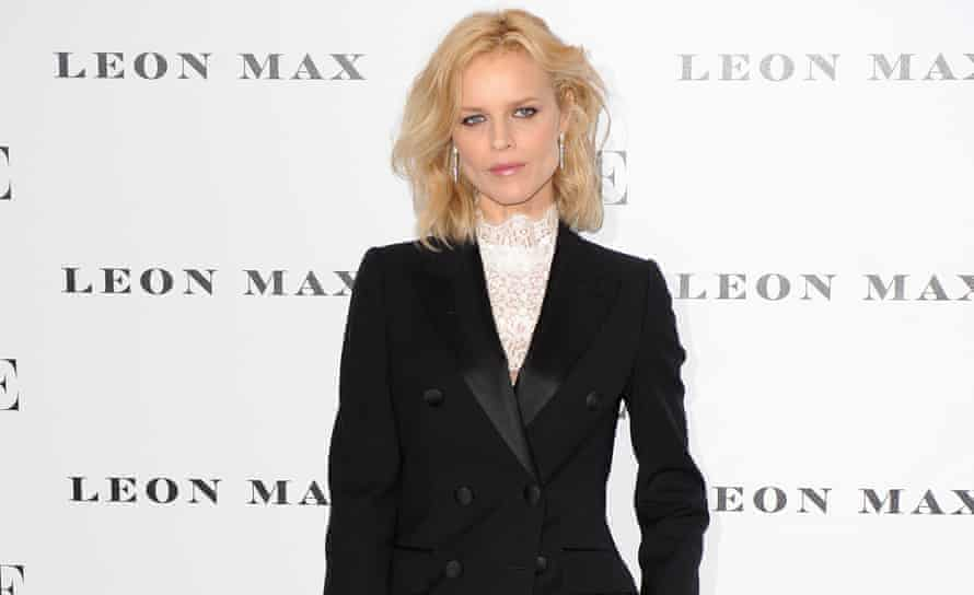 Eva Herzigová wore a pie-crust collared white blouse under a trouser suit for the Vogue centenary party.