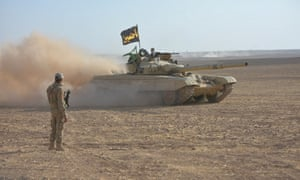 Iraqi armed vehicles during an operation to attack Isis militants near Mosul, Iraq