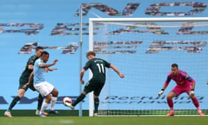 Manchester City's Gabriel Jesus has a shot on goal but the ball deflects off both Matt Ritchie (11) and Federico Fernandez (left) for an own goal.