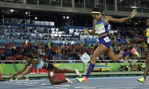 Bahamas' Shaunae Miller falls over the line to take the 400m title