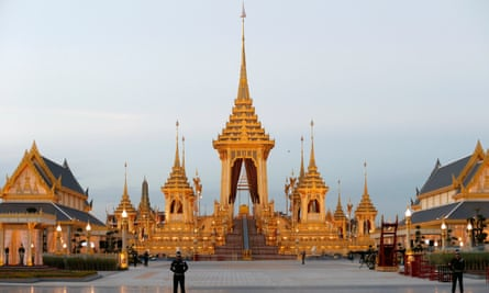 Military officers stand guard at the newly completed royal crematorium for Bhumibol Adulyadej during a dress rehearsal.