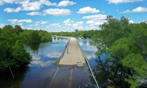 Floodwater from the Mississippi River cuts off the roadway from Missouri into Illinois at the states' border in Saint Mary, US