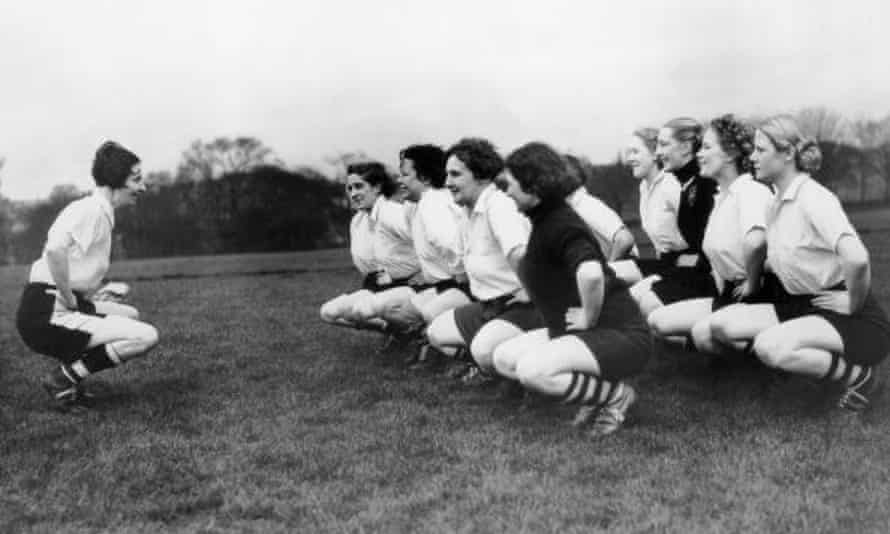 Lily Parr (left), pictured leading Preston training as their captain.