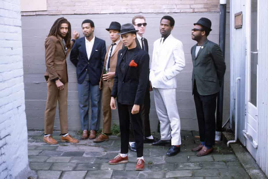Pauline Black (front) and the Selecter, including Noel Davies (behind Black).