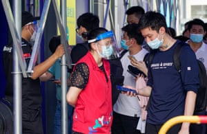 People with yellow health codes queue up at a nucleic acid testing site on 21 June 2021 in Shenzhen, Guangdong Province of China.