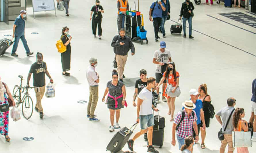Travellers at Waterloo station, London
