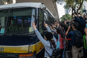 Hong Kong, China. Supporters react as a a vehicle leaves the West Kowloon magistrates' court after pro-democracy activists Joshua Wong, Agnes Chow and Ivan Lam were sentenced over a protest took place outside the police headquarters in 2019