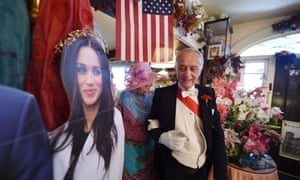 Edmund Fry leads guests past a cardboard cutout of Meghan Markle to their tables for traditional afternoon tea at the Rose Tree Cottage in Pasadena, California on 15 May. Markle has previously been a guest at the tea room.