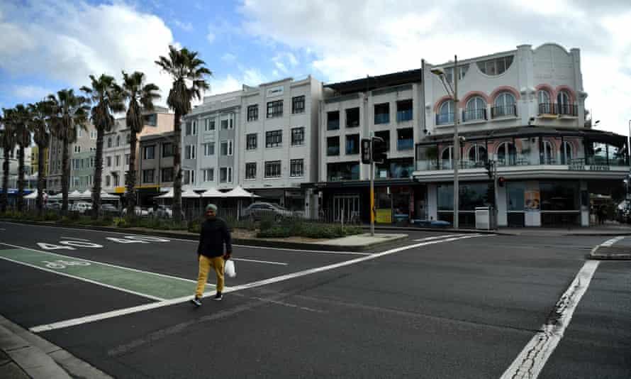 People walk past closed shops at Bondi Beach in Sydney as Covid outbreaks emerge across Australia