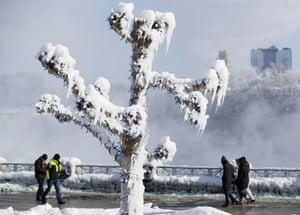 Ontario, CanadaPeople walk by trees covered in ice from the mist of Niagara Falls. A brutal cold wave moved eastward after bringing temperatures in the US Midwest lower than those in Antarctica.