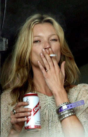 Getting her 'side of the stage' face on in a cream coloured sheer top with a glitter stitching, 2007. Fag in hand and can of Red Stripe are optional.