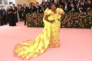 Co-host Serena Williams in a neon yellow gown with matching sneakers