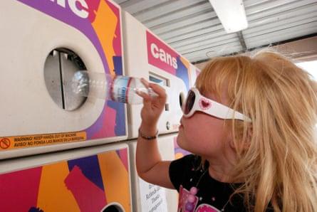 Little girl returning a plastic bottle