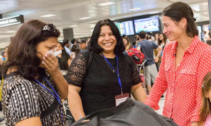 Shaista, center, and Rahila Sadiq, refugees from Pakistan, arrive at Dulles international airport outside Washington DC.