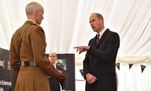 Prince William presents Col Mike Duff with the Firmin Sword of Peace for the department's work on the novichok incident.