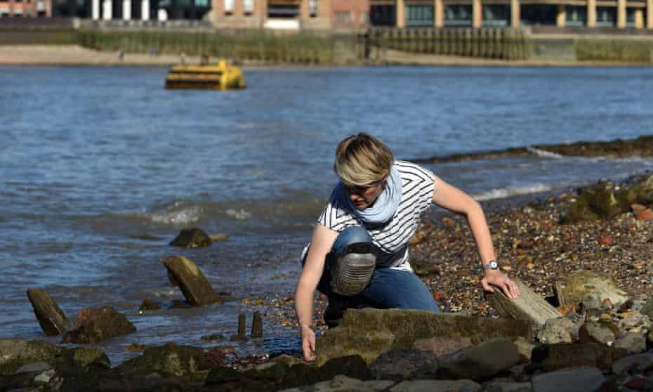 Lara Maiklem 'mudlarking' on the Thames foreshore in London.