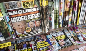 Copies of the National Enquirer on shelves