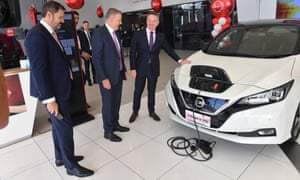Ed Husic, Anthony Albanese and Chris Bowen with an electric vehicle as part of the ALP national conference on Wednesday