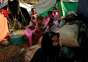 Rohingya people rest at a makeshift shelter in No Man's Land after crossing the Bangladesh-Myanmar border fence, in Cox's Bazar, Bangladesh, August 29, 2017. REUTERS/Mohammad Ponir Hossain