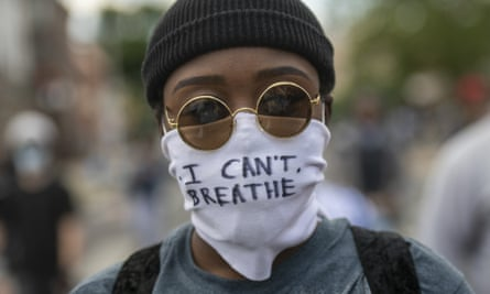 A protester marches in Philadelphia, Pennsylvania, on Sunday.