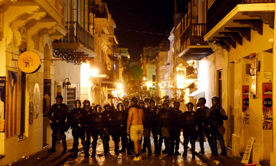A protestor confronts riot police during demonstrations in Old San Juan, Puerto Rico, in July.