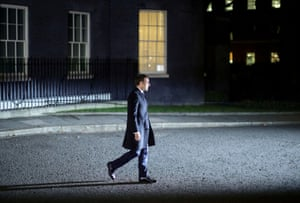 The French president, Emmanuel Macron, leaves Downing Street after talks with Boris Johnson ahead of the Nato summit in Watford.