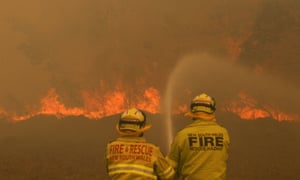 Firefighters work to contain a bushfire in Old Bar, NSW