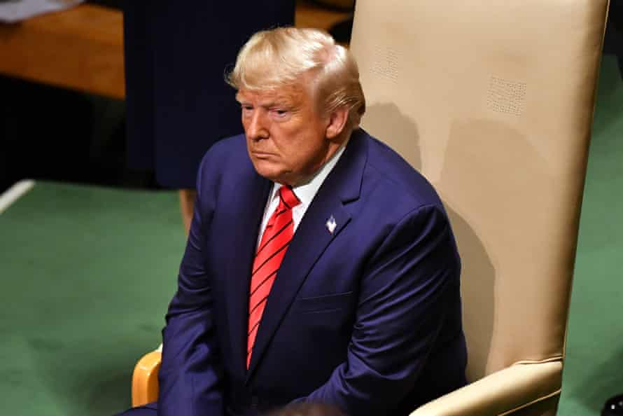 Trump waits to give his address.