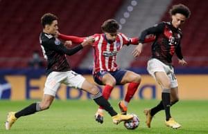 Jamal Musiala tackles João Félix on Tuesday, with Leroy Sané close by.