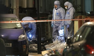 Forensic investigators at the scene in Leyton, Waltham Forest in east London where a 14-year-old boy died after he was found with stab injuries