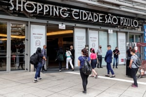 People visit a mall center in Sao Paulo, Brazil, on 18 April 2021. Sao Paulo state in Brazil is easing pandemic-related restrictions, allowing the opening of churches and shops despite Covid-19 figures remaining high in the country.