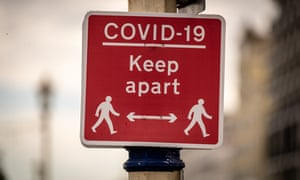 A 'Covid-19 keep apart' physical distancing sign is seen in Eastbourne