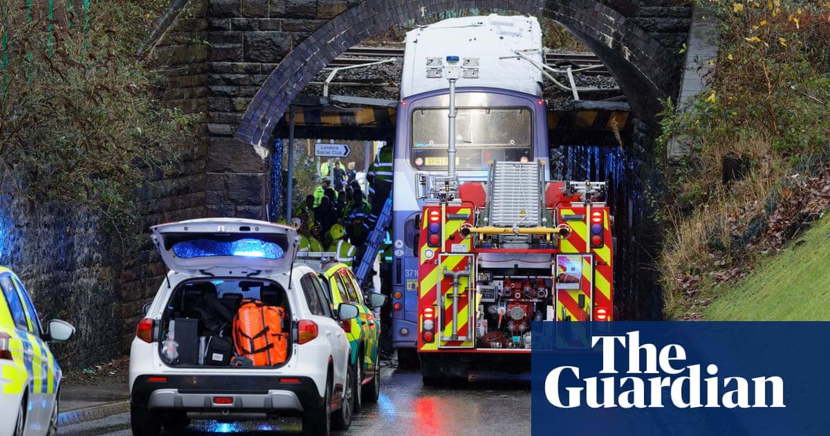 Double-decker bus crashes into railway bridge in Swansea