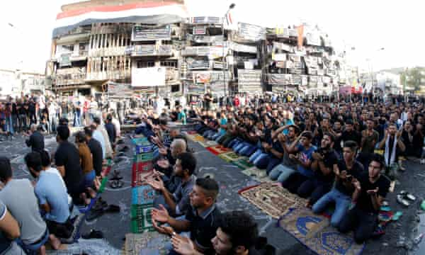 Sunni and Shi'ite Muslims at Eid prayers at the site of the Baghdad attack.