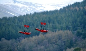 Participants at a zip wire attraction in north Wales. Zip World, Penrhyn Quarry, Bethesda, Bangor, Gwynedd, North Wales the fastest zip wire in the worldD67C6M Zip World, Penrhyn Quarry, Bethesda, Bangor, Gwynedd, North Wales the fastest zip wire in the world