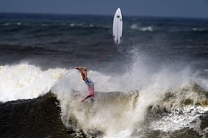 Brazil's Gabriel Medina crashes on a wave during the bronze medal heat of the men's surfing competition