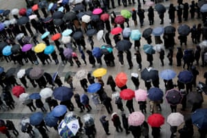 People wait in a line to buy masks as rain falls in front of a department store in Seoul, South Korea,