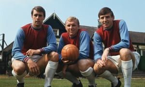 West Ham players Martin Peters, right, with Geoff Hurst, left, and Bobby Moore, take a break from training.