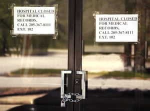 Closed signs hang on a recently closed Pickens County Medical Center in Carrollton, Alabama, in 26 March 2020.